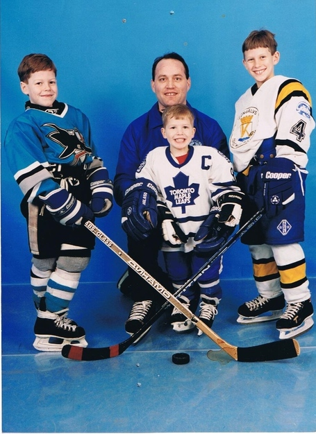 (Left to right): Matt Clune, Ben Clune, and Preds pest Rich Clune as children, pictured with their father, Coach Tom Clune at Ted Reeve Skating Hockey School.